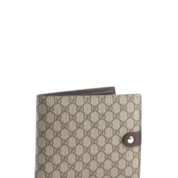 Gucci: beige GG print coated canvas bi-fold wallet