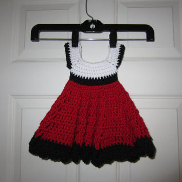 Minnie Mouse inspired handmade crochet dress in white, black and red.  Fits newborn, infant, baby 0-3 months