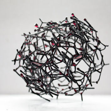 Small decorative ball made out of chicken wire & red resin