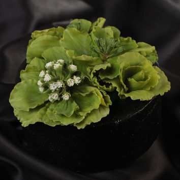 Small green handmade polymer clay flower composition in pot for home decor