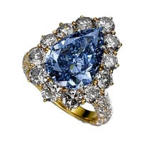 Pear blue diamond yellow gold anniversary ring