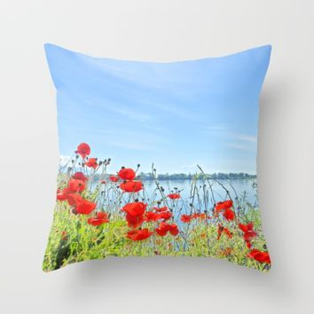 Red poppies in the lakeshore Throw Pillow by ARTbyJWP