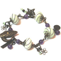 Bracelet of Venetian Style Hand Blown Glass with Amethyst and Swarovski Crystal Beads and Natural Brass Charms