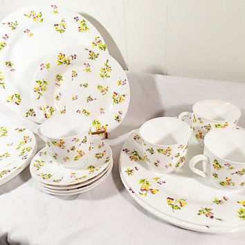Vintage Martha Stewart Yellow and Purple Pansies 16 piece set. 4 piece place settings includes dinner plates salad plates cups and saucers