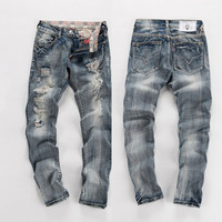Men's Ripped Light Wash Jeans
