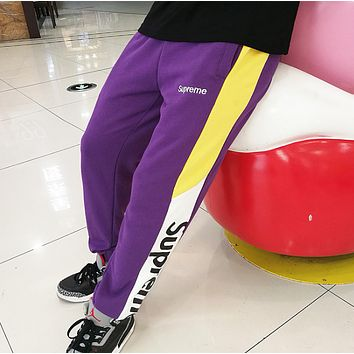 Supreme New fashion embroidery letter and letter print couple splice sports leisure pants Purple