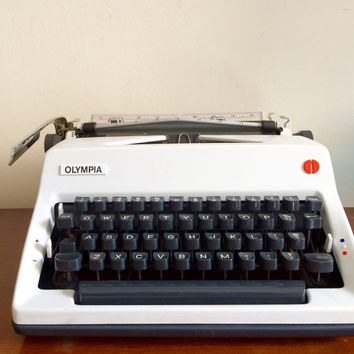 Working olympia white manual typewriter