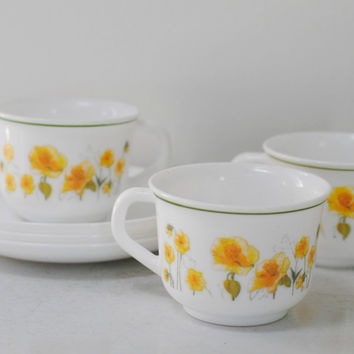 Vintage arcopal milk glass tea cups and saucers with yellow poppy flowers