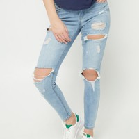 Light Wash Mid Rise Destroyed & Sandblasted Skinny Jeans in Regular