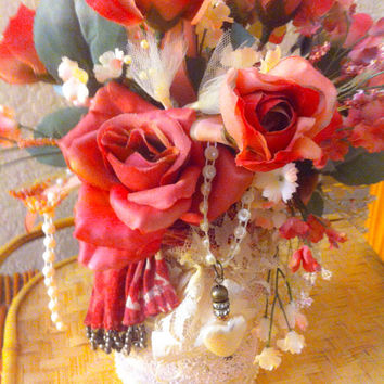 Shabby cottage chic floral arrangement in hand painted mason jar with pearls and ribbon accents. Pink roses, lace and pearl hear charm .
