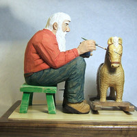 Hand Carved Wood Santa with Rocking Horse in his Workshop the night before Christmas Eve.