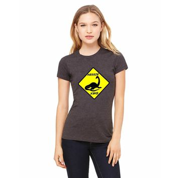 "Bella + Canvas Fitted Tee With A Loch Ness Monster ""Nessie XING"" Sign Design"