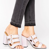 The March Buckle Strappy Mid Heeled Mules at asos.com