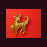 Proud strutting afghan hound brooch. Stamped A 400