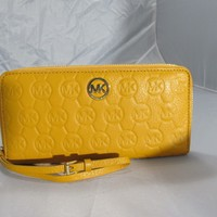 MICHAEL KORS MARIGOLD LEATHER MONO EMBOSSED ZIP AROUND CONTINENTAL WALLET