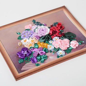 Handmade satin ribbon embroidery with flowers still life in a wooden frame