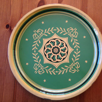 Vintage green and gold metal jewelry or serving trays. Circa 1930s/1940s.