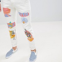 ASOS Stretch Slim Jeans In Ecru With Prints at asos.com