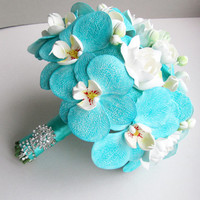 Blue, turquoise, aquamarine orchid bouquet with white gardenias. Phalaenopsis bouquet