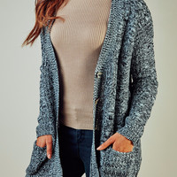 OVERSIZED CABLE KNIT BUTTON-UP CARDIGAN
