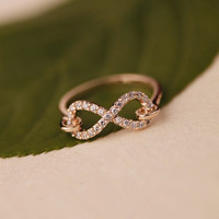 L 082402 Infinity symbol zircon diamond ring