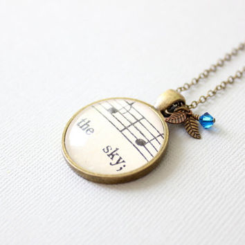 Sky necklace. Vintage sheet music jewelry. Unique charm necklace with blue Swarovski crystal and leaves