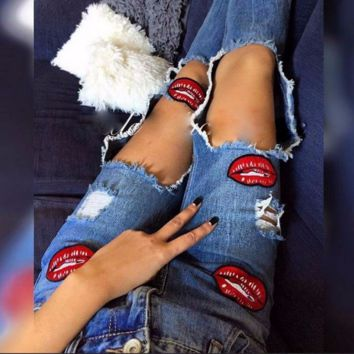 Joining together Ripped A pair of jeans