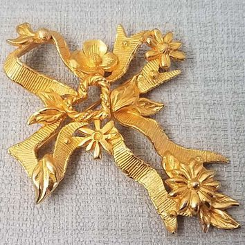 Lovely gold metal vintage CHRISTIAN LACROIX brooch 80s