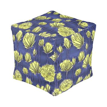 Abstract floral pattern, yellow flowers on blue pouf