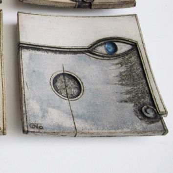 ceramic square decorative plate with face, blue and grey