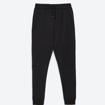 TECHNICAL TROUSERS WITH KNEE DETAIL