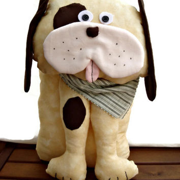 Sweet patchwork stuffed dog with a green handkerchief on the neck.
