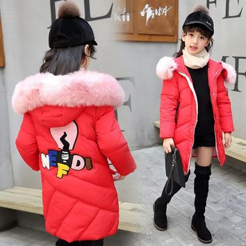 Winter Down Jacket Girl Warm Winter Coat New Year  A Lively Girl Dressed In Cotton-padded Clothes In Park Happy To Play
