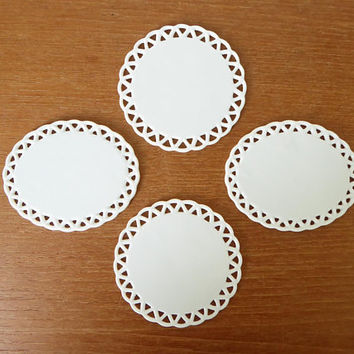 Eight small white porcelain wall plates, dry erasable porcelain discs with lace edge, porcelain ornament blanks made in Japan