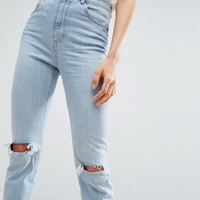 ASOS FARLEIGH High Waist Slim Mom Jeans In Beech Light Stonewash with Busted Knees and Chewed Hems at asos.com