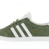 S77295 Base Green/Footwear White/Gold MT Adidas Gazelle OG Titolo