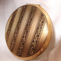 Attractive Stratton gold tone compact. Excellent unused condition, original box, label, sifter, puff & pouch. Anniversary, birthday gift.