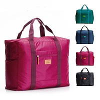 Foldable brand designer luggage travels bags organizer waterproof women and men duffle carry on luggage traveling bag