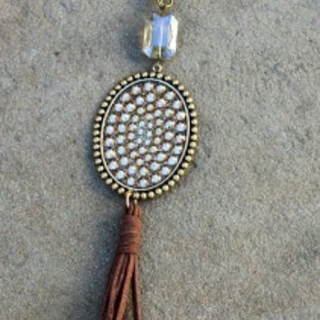 Pink Panache Long Chain and Crystal Necklace with Large Oval Covered in Topaz Crystals and Brown Tassel