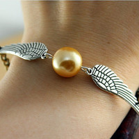 Harry Potter Golden Snitch bracelet, with silver double side wings