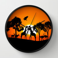 Giraffe silhouettes at sunset Wall Clock by Laureenr