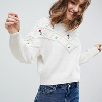 ASOS Sweater with Pom Poms and Floral Embroidery at asos.com