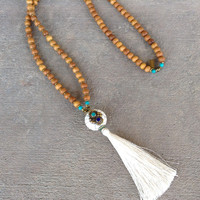 Sandalwood, Hand made Silk Tassel, and Tibetan guru bead 108 bead mala necklace