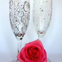 Wedding Flutes, One with Gray black swirls and one white swirls both have SwarovskiCrystals on it . Great for wedding