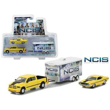 "2015 Dodge Ram 1500 Pickup Yellow with 1970 Dodge Challenger R/T Yellow with Enclosed Car Trailer which has Opening Rear Hatch ""NCIS"" (2003-Current TV Series) Hollywood Hitch and Tow Series 4 1/64 Diecast Model by Greenlight"