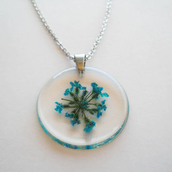 Transparent round pendant, stainless steel chain and bail, turquoise blue Queen's Ann lace real flowers, resin jewelry necklace