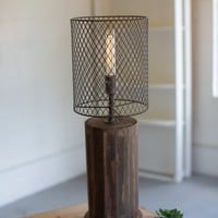 Round Recycled Wooden Table Lamp With A Wire Mesh Shade