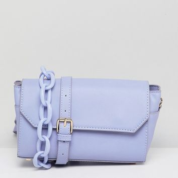 ASOS DESIGN bowler bag with statement strap at asos.com