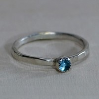 Hammered sterling silver stacking ring with blue topaz stone