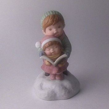 Vintage Avon Christmas Musical Box Porcelain Figurine: Two Childrens Caroling.